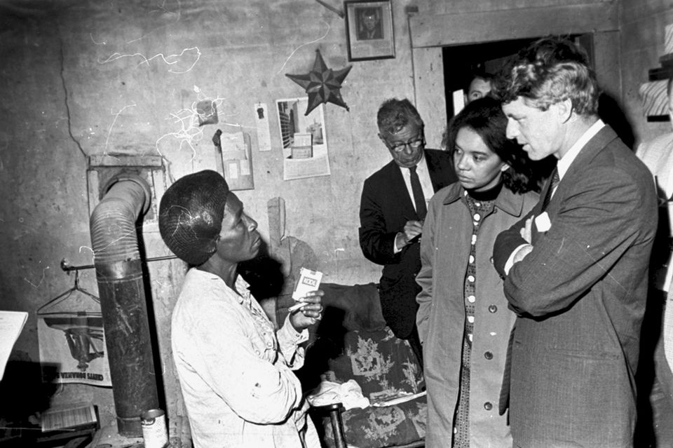 Kennedy stood with Marian Wright Edelman (second from right) as they visited Greenville, Miss., during an anti-poverty investigation in 1967.