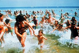 "Beach-goers run from the water in ""Jaws."" Martha's Vineyard was the onscreen stand-in for fictional Amity Island."