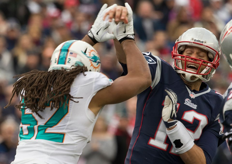 Philip Wheeler arrives just as Tom Brady is throwing a 14-yard TD pass to Aaron Dobson.