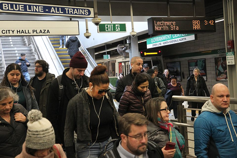 Commuters at Government Center station on Monday.