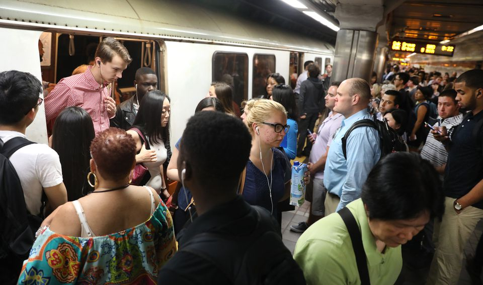 Riders got on and off trains at Downtown Crossing station.