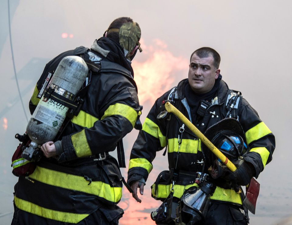 Firefighters at the scene of the fire.