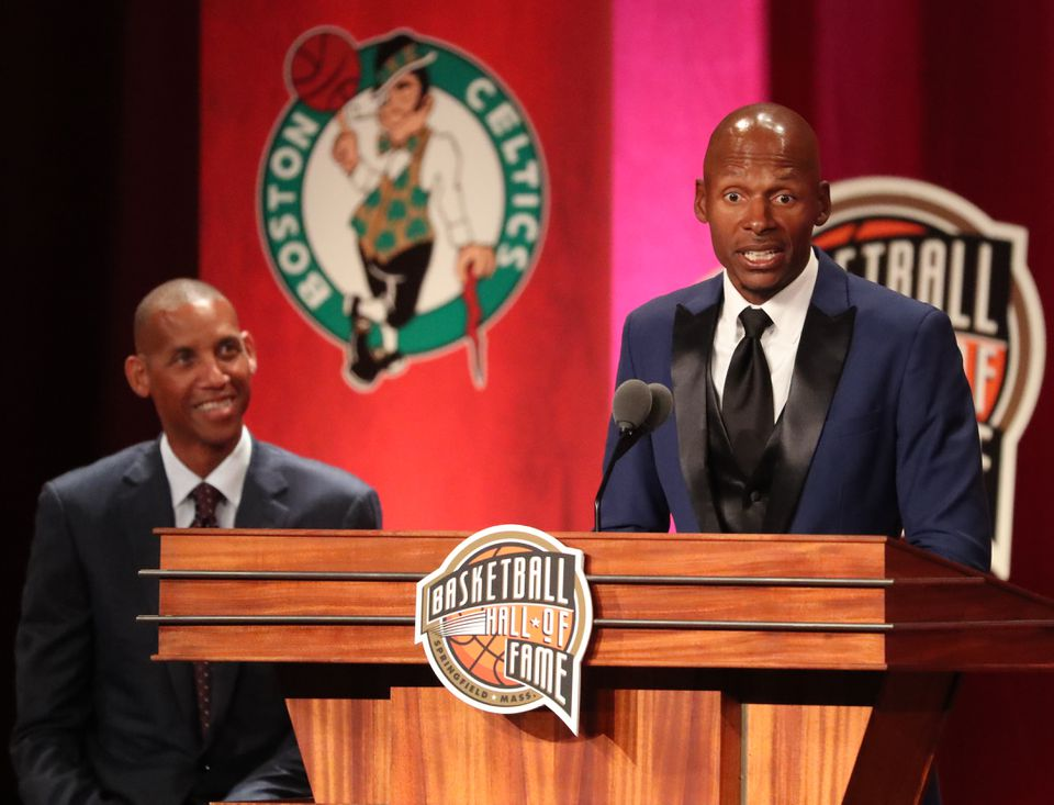As presented Reggie Miller watches, Ray Allen (right) gives his acceptance speech at the Naismith Memorial Basketball Hall of Fame enshrinement ceremony.