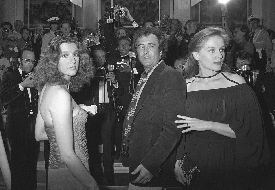 "Italian actress Stefania Sandrelli (left), Italian director Bernardo Bertolucci (center) and French actress Dominique Sanda arrived at the Festival Palace in Cannes to present the Italian film ""Novecento"" in 1976."