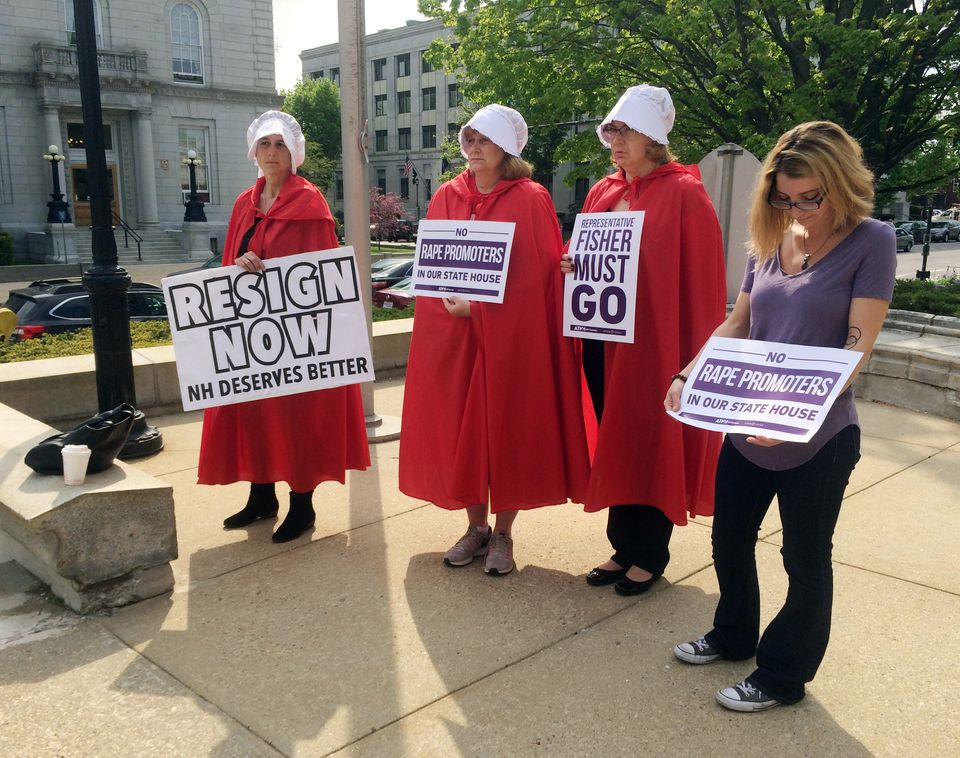 Women protested a New Hampshire legislator's online forum in Concord this month.