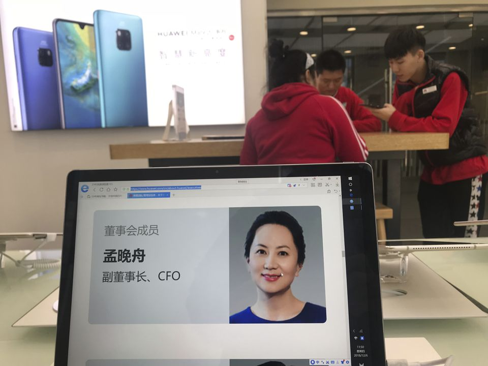 Huawei CFO Meng Wanzhou, shown here on a computer at a company store in Beijing.