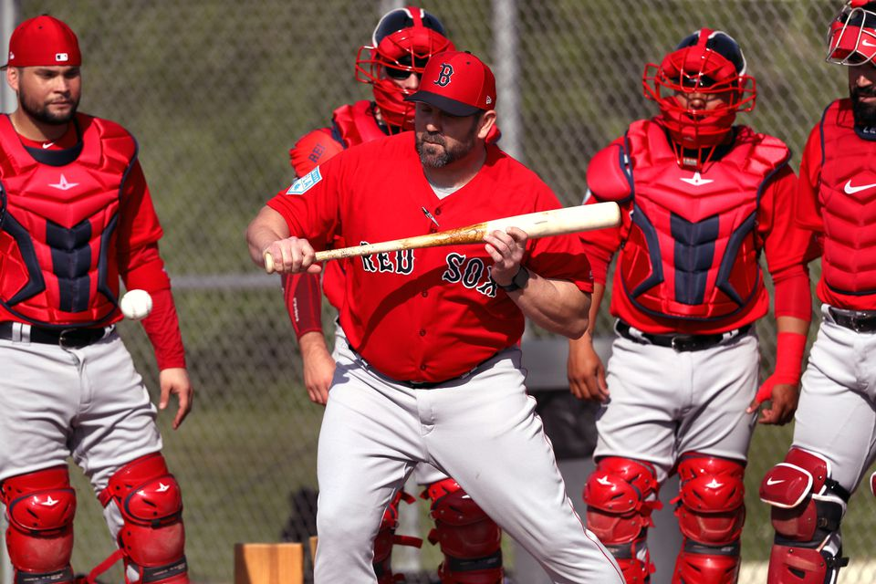 Former Red Sox catcher Jason Varitek stood in as the batter as pitchers worked on fielding bunts to the third base side.