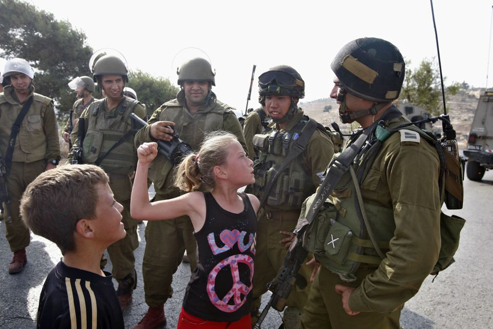 In this 2012 photo, a 12-year-old Ahed Tamimi tried to punch an Israeli soldier during a protest in the West Bank village of Nabi Saleh. Today, Tamimi faces charges of assault and incitement.