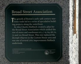 A historical marker on the Bulfinch building's column.