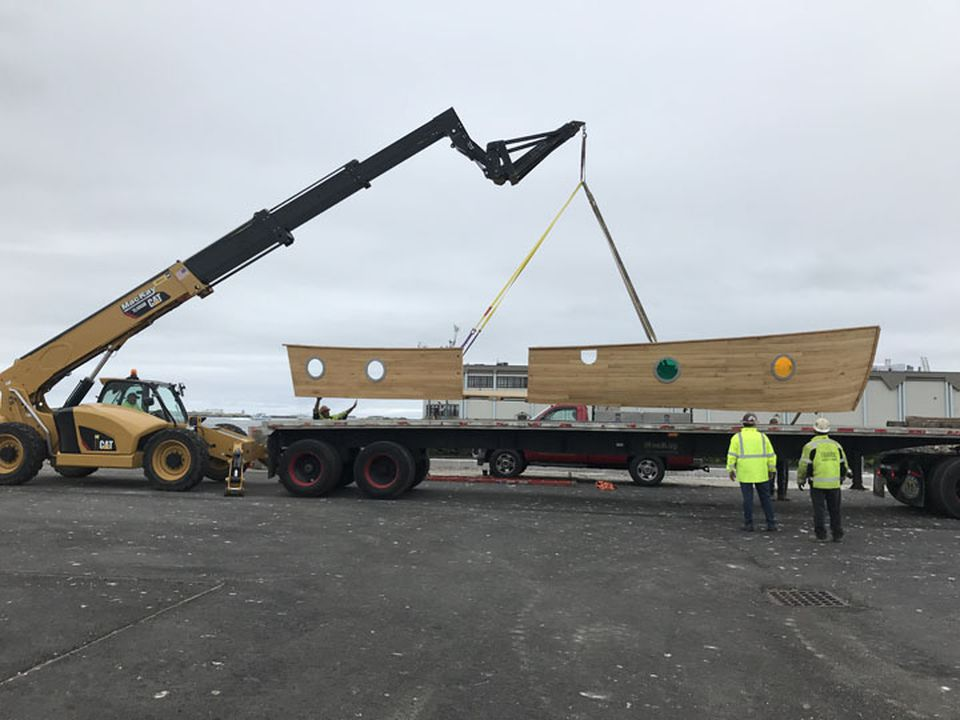 A boat that will be placed in the Seaport arrived in Boston. The site (above) is under construction but the park, in memory of a victim of the Boston Marathon bombings, is expected to be finished soon.