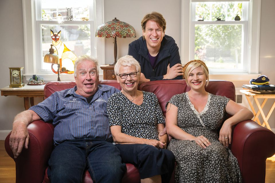Pete Holmes with his parents Jay and Irena, and his wife, Valerie Chaney, at his parents' home  in Arlington.