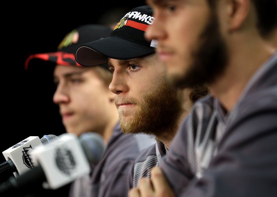 Blackhawks right wing Patrick Kane listens to a question during a news conference Sunday.