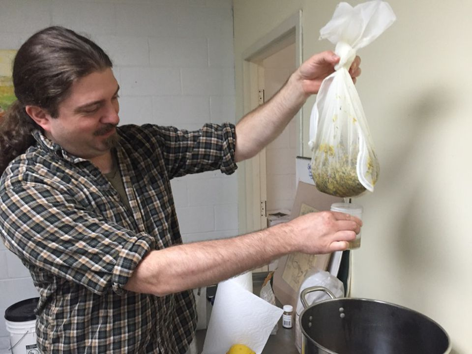 Rich Loomis of Brew & Wine Hobby in East Hartford, Conn., gives a lesson in making dandelion wine.
