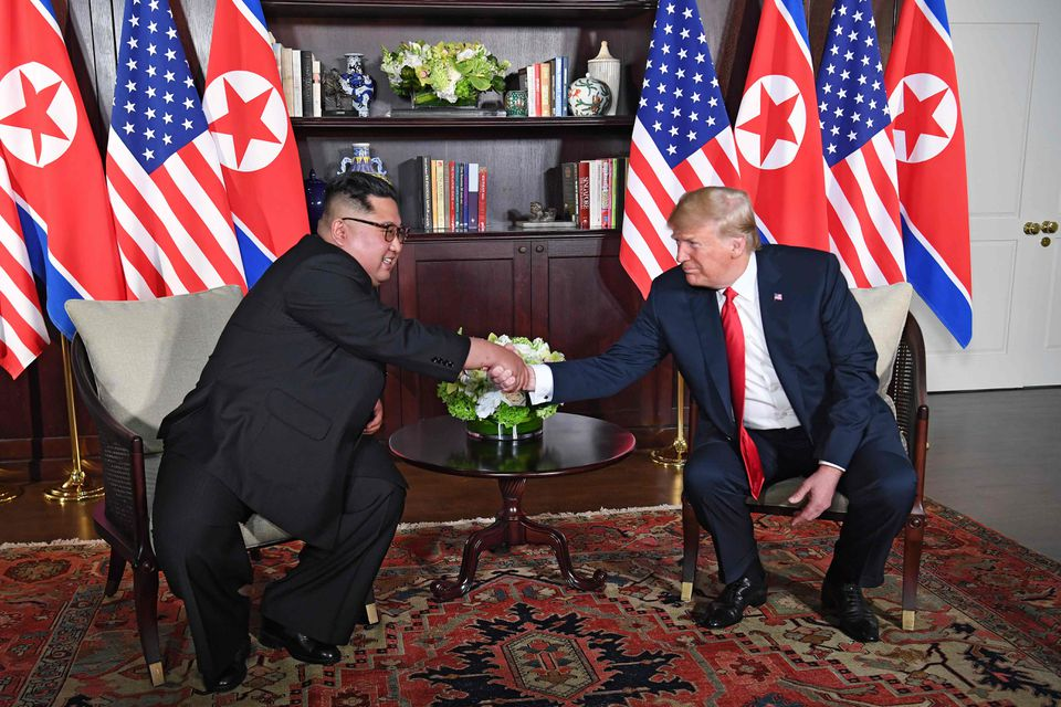 Kim and Trump shook hands while sitting down during their one-on-one session.