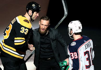 ff22f164747 Bruins captain Zdeno Chara (left) shakes hands with MMA fighter Conor  McGregor after the