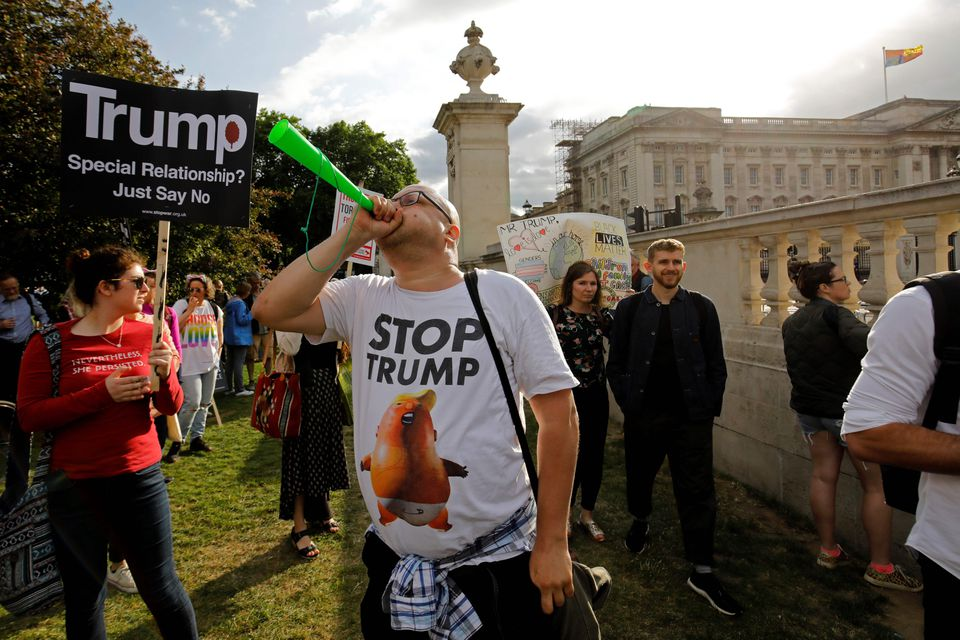 President Trump fan hit by milkshake as protesters shout 'Nazi scum'