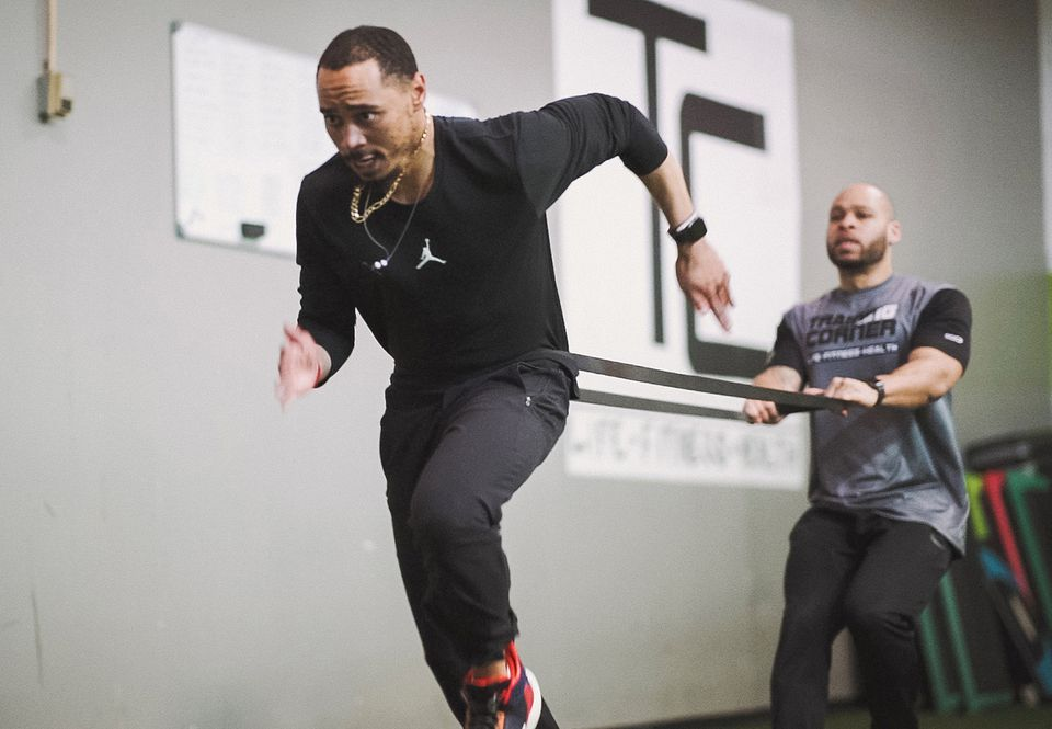 Red Sox outfielder Mookie Betts works with trainer Deon Giddens at The Training Corner in Nashville