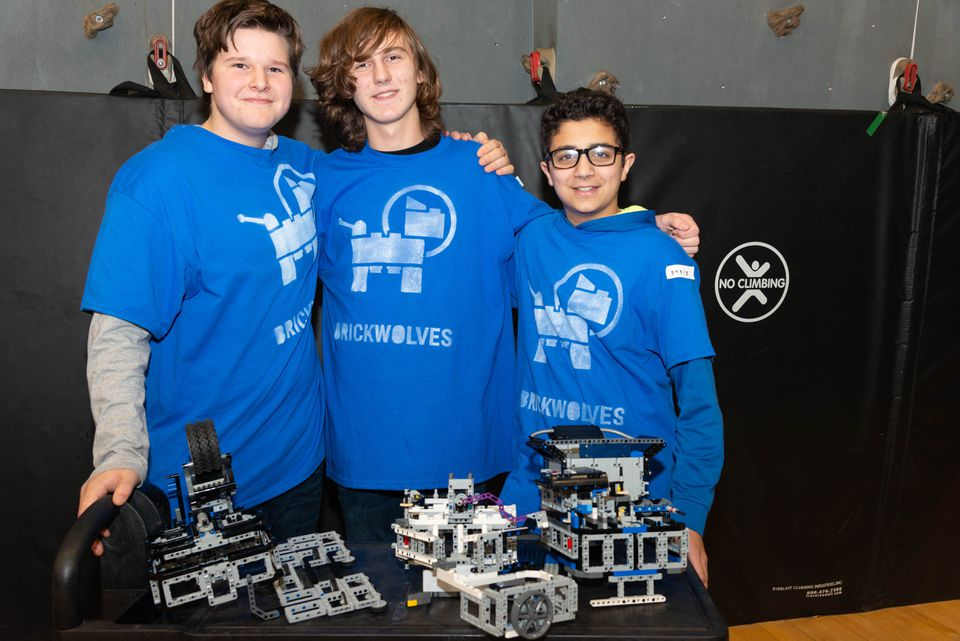 "Peter Hanna, Owen Cooper, and Chris Douglas pose with parts of their robot, ""Stormageddon; Dark Lord of All."""