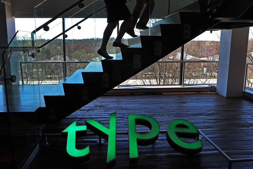 "A large green ""TYPE"" sign is prominent in the offices of Monotype, the biggest maker and owner of fonts in the world."