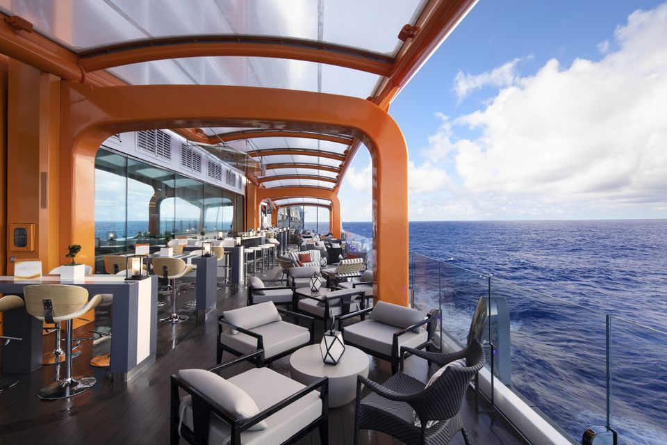 The highlight of Celebrity Edge's outward-facing vision, Magic Carpet is the world's first cantilevered, floating platform that reaches heights of 13 stories above sea level.