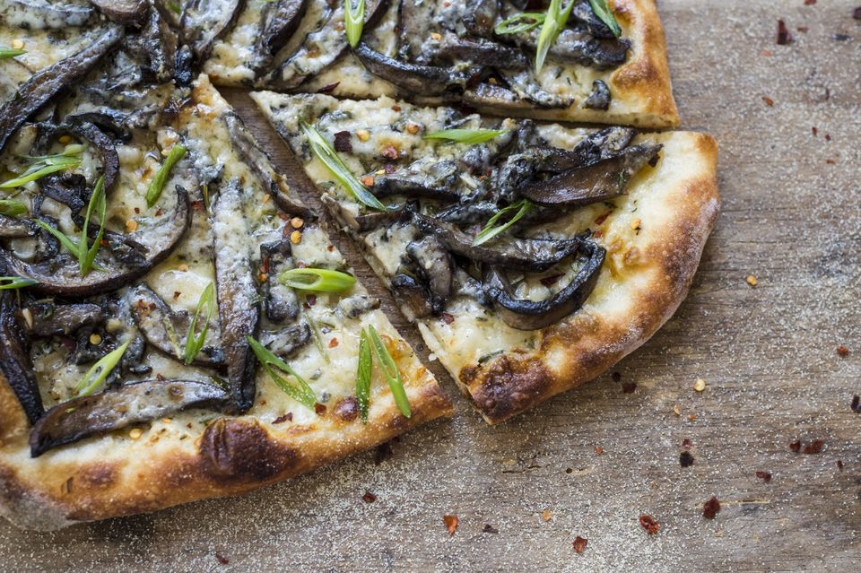 Roasted mushroom pizza with fontina and scallions.