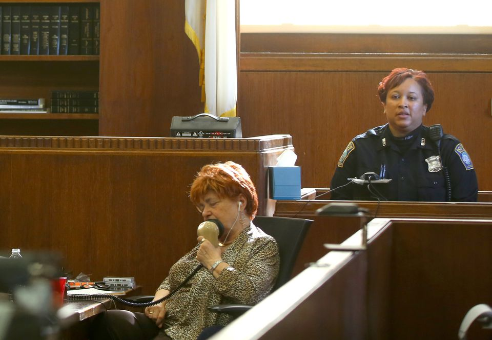 A court reporter worked while Boston Police Officer Nichole Tyler testified.