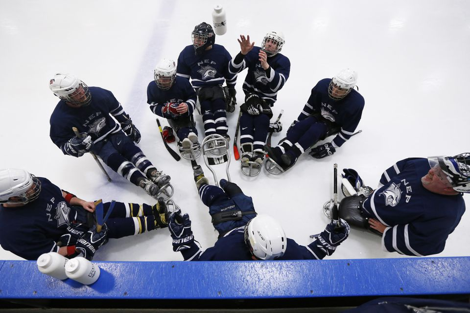 The Northeast Passage Wildcats between periods of their sled hockey game against the New Jersey Freeze at the Newington (Conn.) Ice Arena.  The Wildcats won, 4-0.