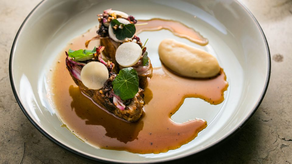 Roasted guinea fowl with buckwheat miso, Jerusalem artichoke cream, and radicchio from ORE.