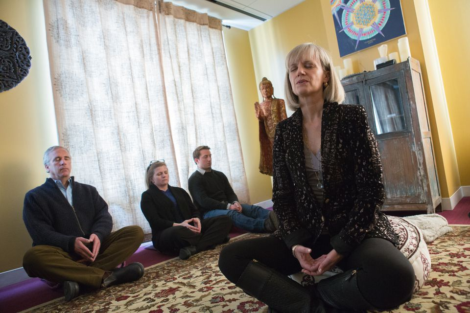 Kip Hollister, chief executive of Hollister Staffing, leads employees in guided meditation in a dedicated room in the company's Boston offices.