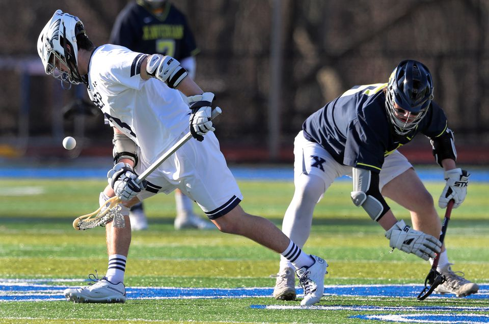 St. John's Prep lacrosse player Craig Yannone (left) is pictured as he wins a faceoff vs. Xaverian's Nick Bloom (right), during a game vs. Xaverian. (Jim Davis /Globe Staff).