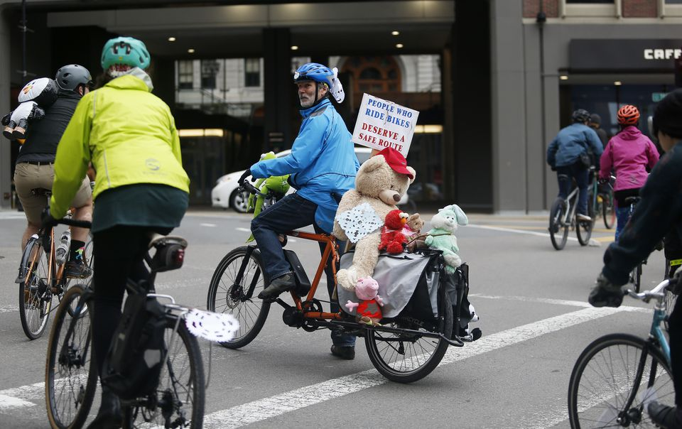 Alan Wright of Roslindale (center) blocked traffic for other bicyclists during Sunday's rally.
