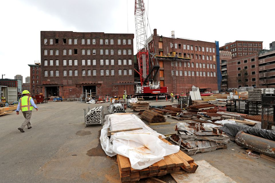 Crews worked on buildings in Fort Point that will eventually house General Electric's smaller-than-planned Boston headquarters.