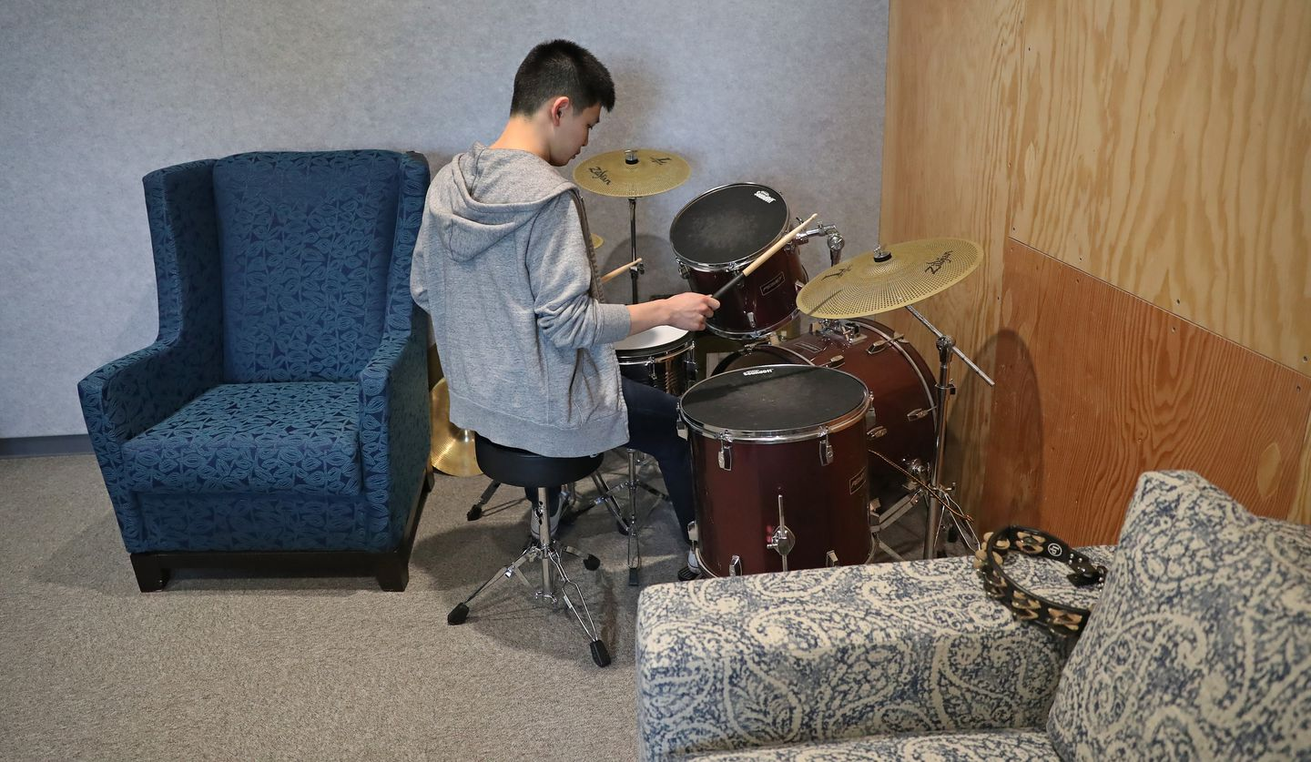 In the music room, Gary Chen, a software engineer, played the drums during a break.