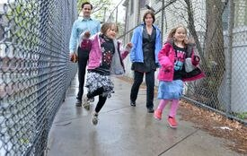 Sage (left) and Alex Herr, on a stroll in Somerville with parents Trish and Hugh.