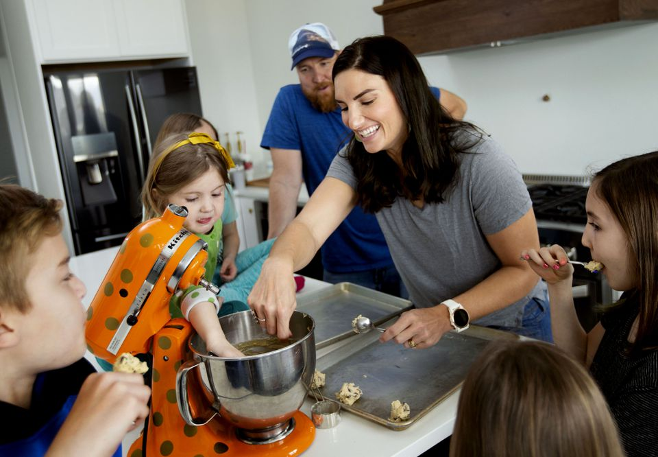 Sarah Bush and her husband, Jon, made cookies with their children, Jonah, 12, Vivienne, 4, twins Pearl and Eloise, 7, and Sophie, 10, at their Utah home.
