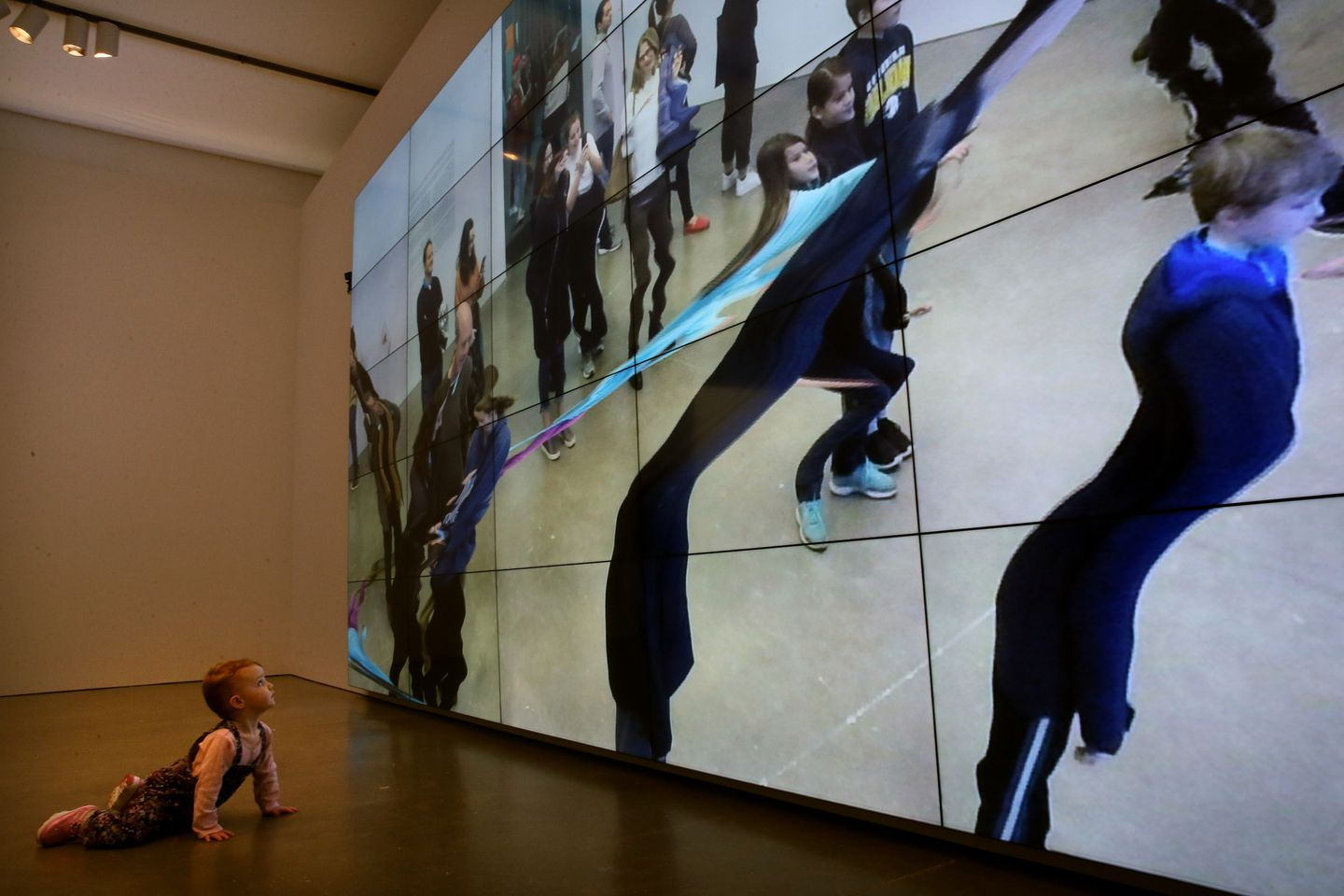 "Olive Wilson, 2, views ""City of Abstracts"" in the ICA's William Forsythe exhibit."
