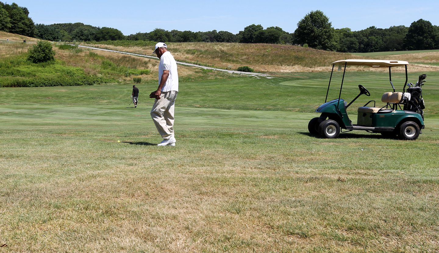 Men played on the 11th fairway in July 2010.