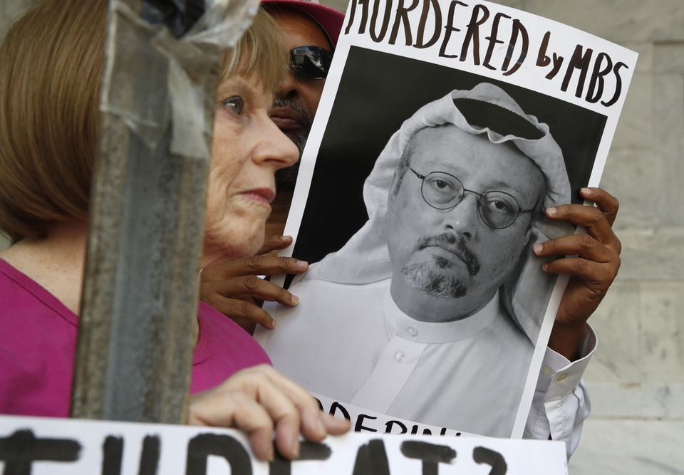 People held signs during a protest at the Embassy of Saudi Arabia in Washington about the disappearance of Saudi journalist Jamal Khashoggi.