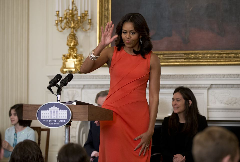 "Diane Paulus (right) sat behind Michelle Obama as the first lady speaks during ""Broadway at the White House."""
