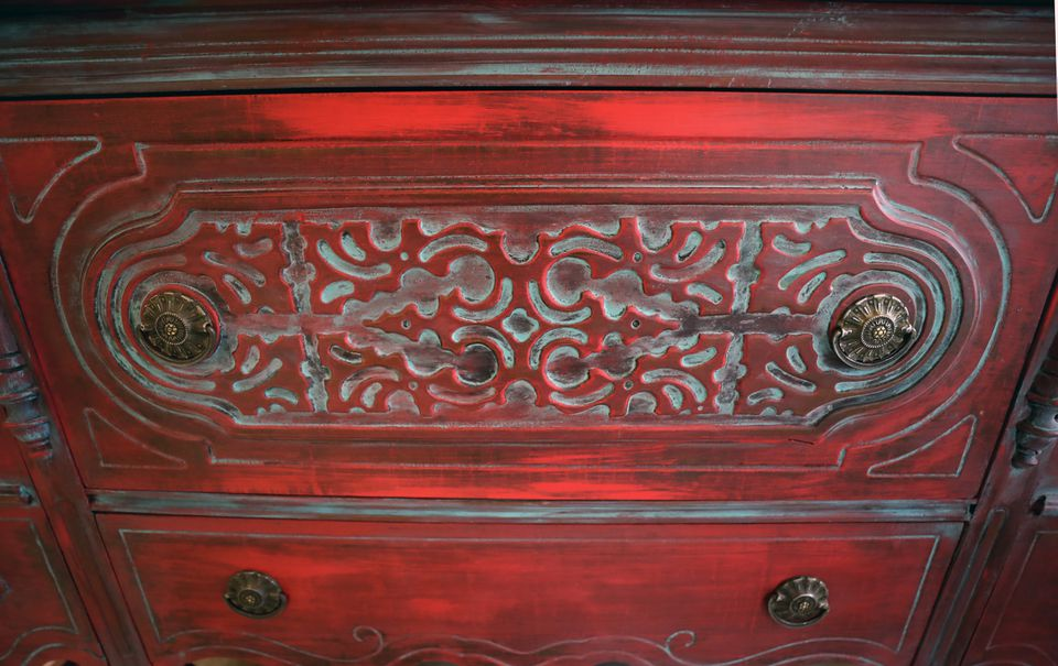 And have fun with color! Here, an antique cabinet has been stained red to show off the detailed woodwork.