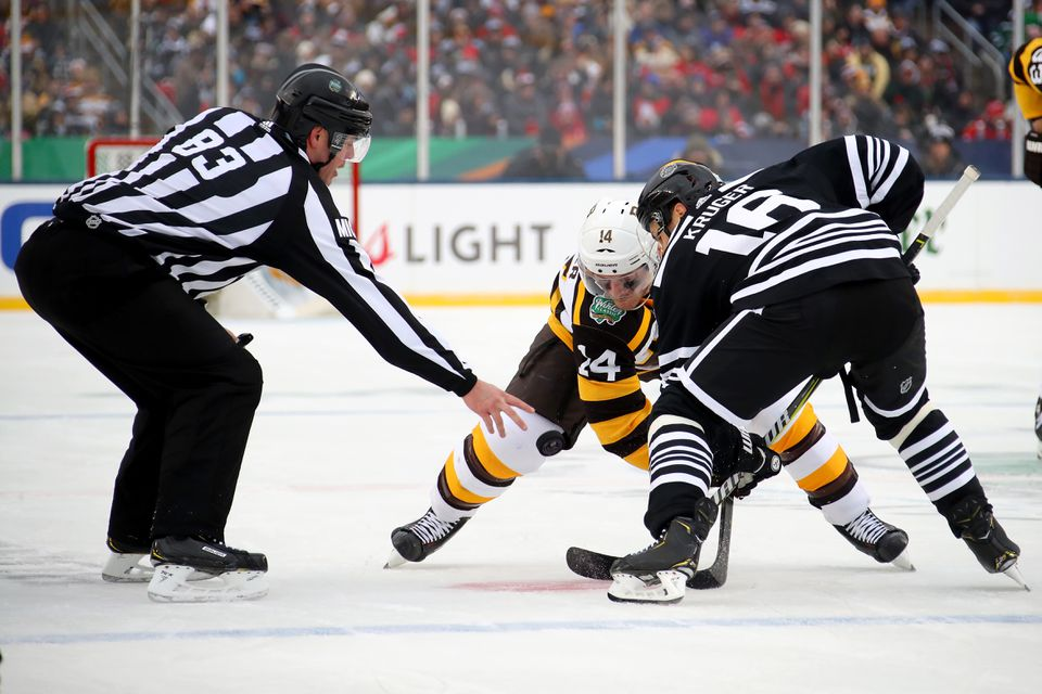Boston's Chris Wagner and Chicago's Marcus Kruger took a faceoff.