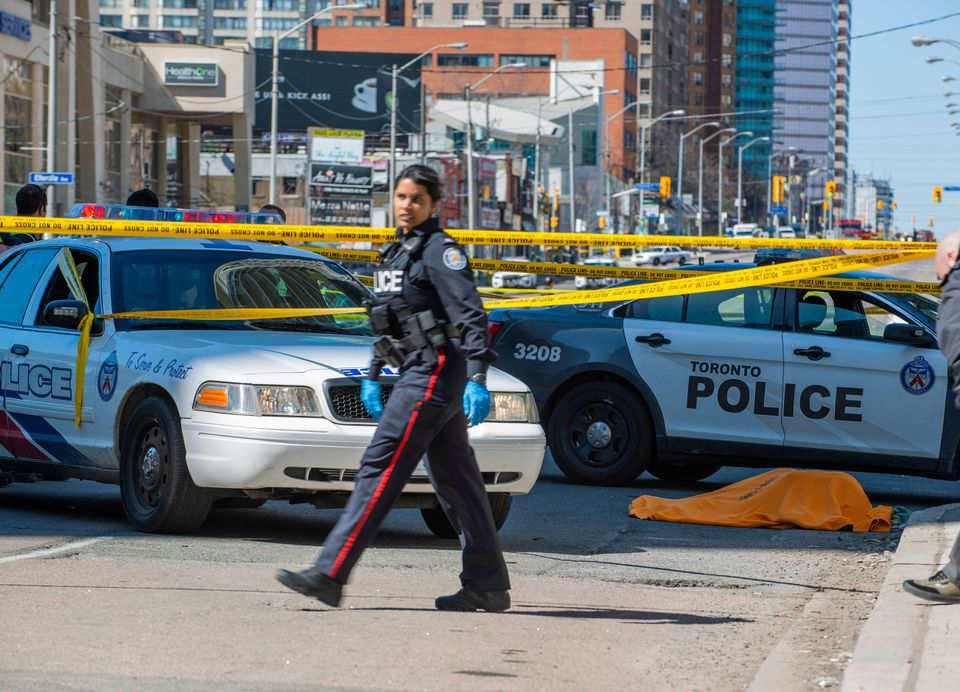 A covered body could be seen on Yonge Street in northern Toronto.