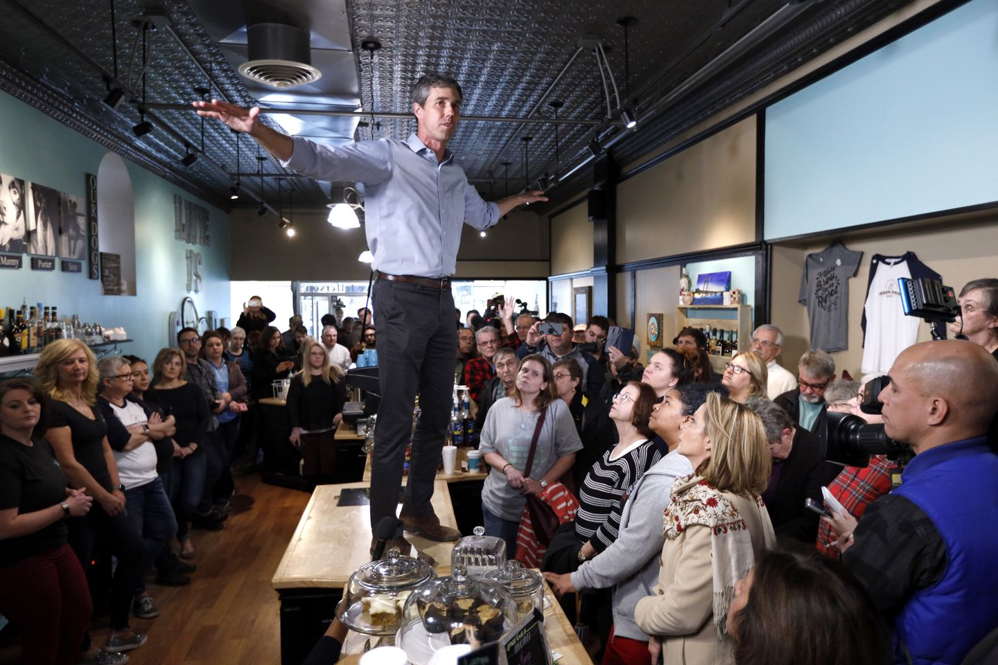 O'Rourke turned a countertop at the Beancounter Coffeehouse & Drinkery in Burlington, Iowa, into something like a surfboard, extending his arms as if riding a gnarly wave at a meet-and-greet.