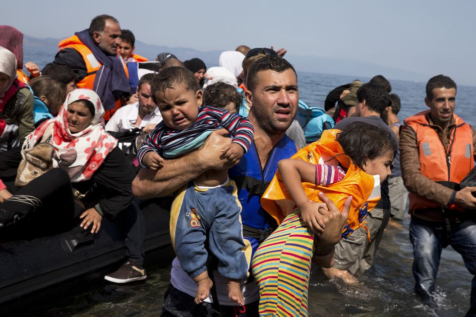 Syrian migrants arrived on the island of Lesbos, Greece, after crossing from Turkey aboard a dinghy on Thursday.