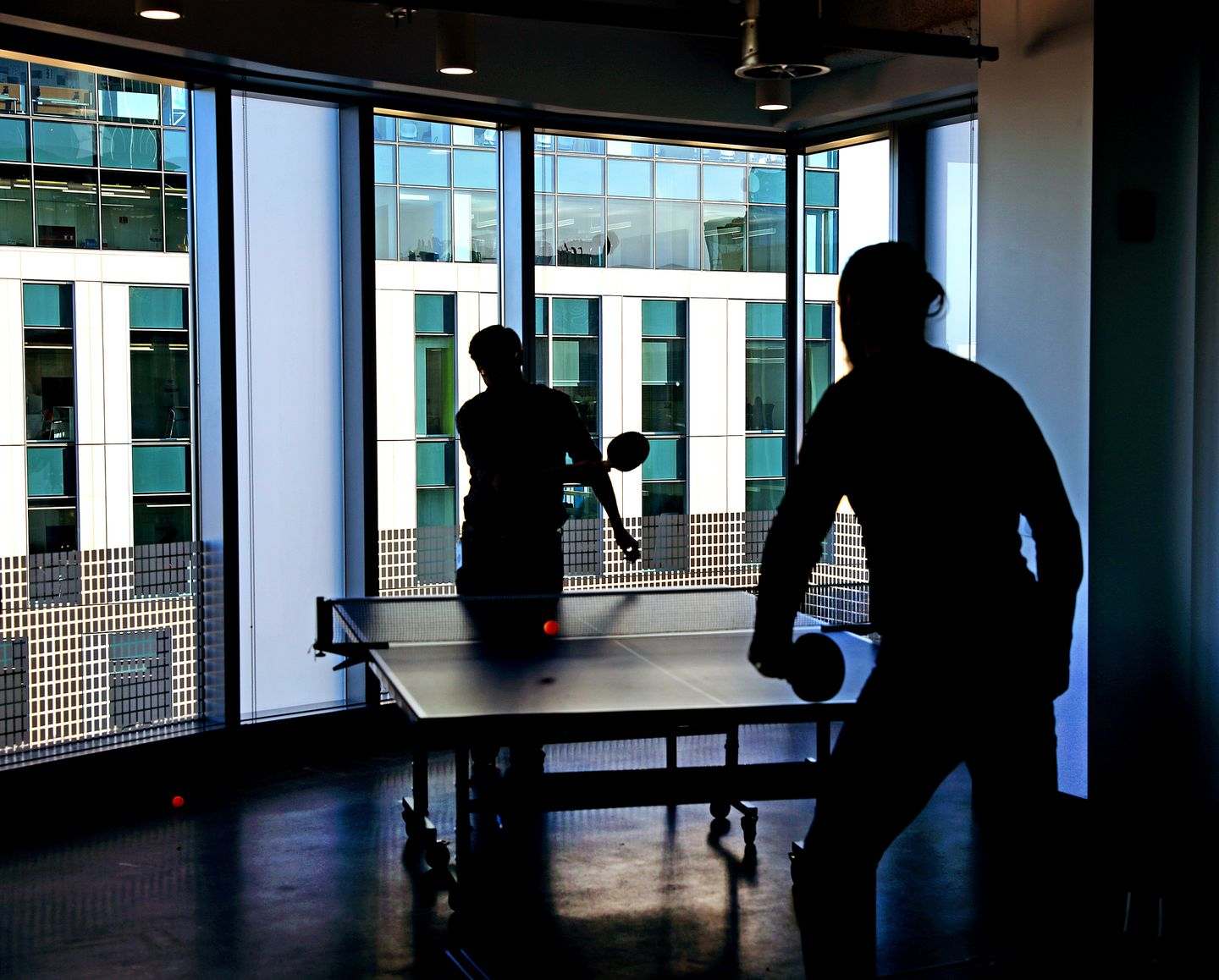 Employees took a break playing table tennis.
