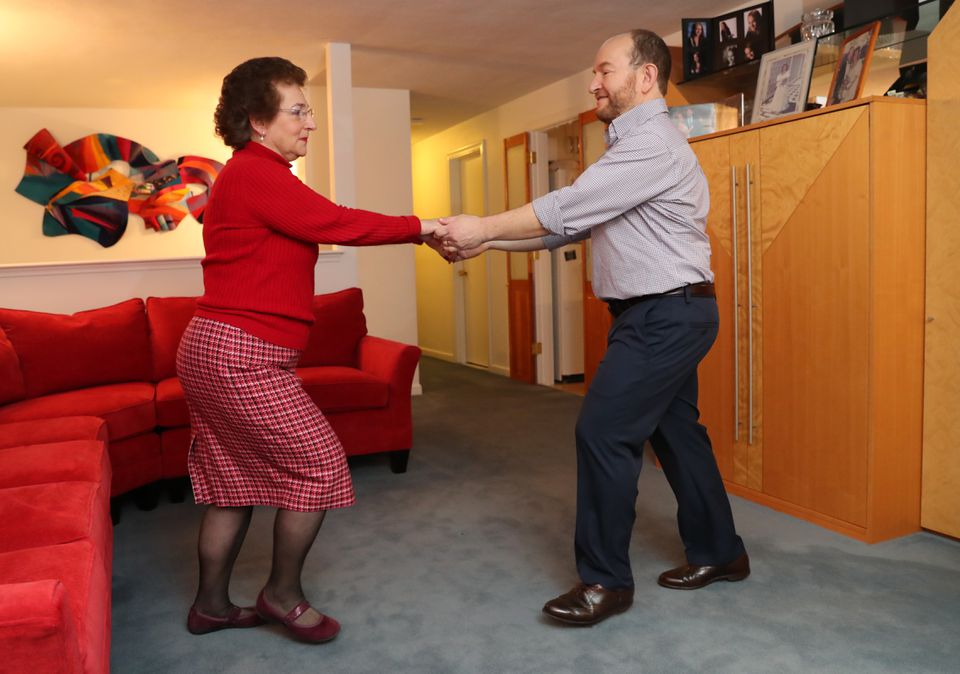 Mind-body therapist Judith Swack dances with her husband, Terry Furman, in their Needham home.