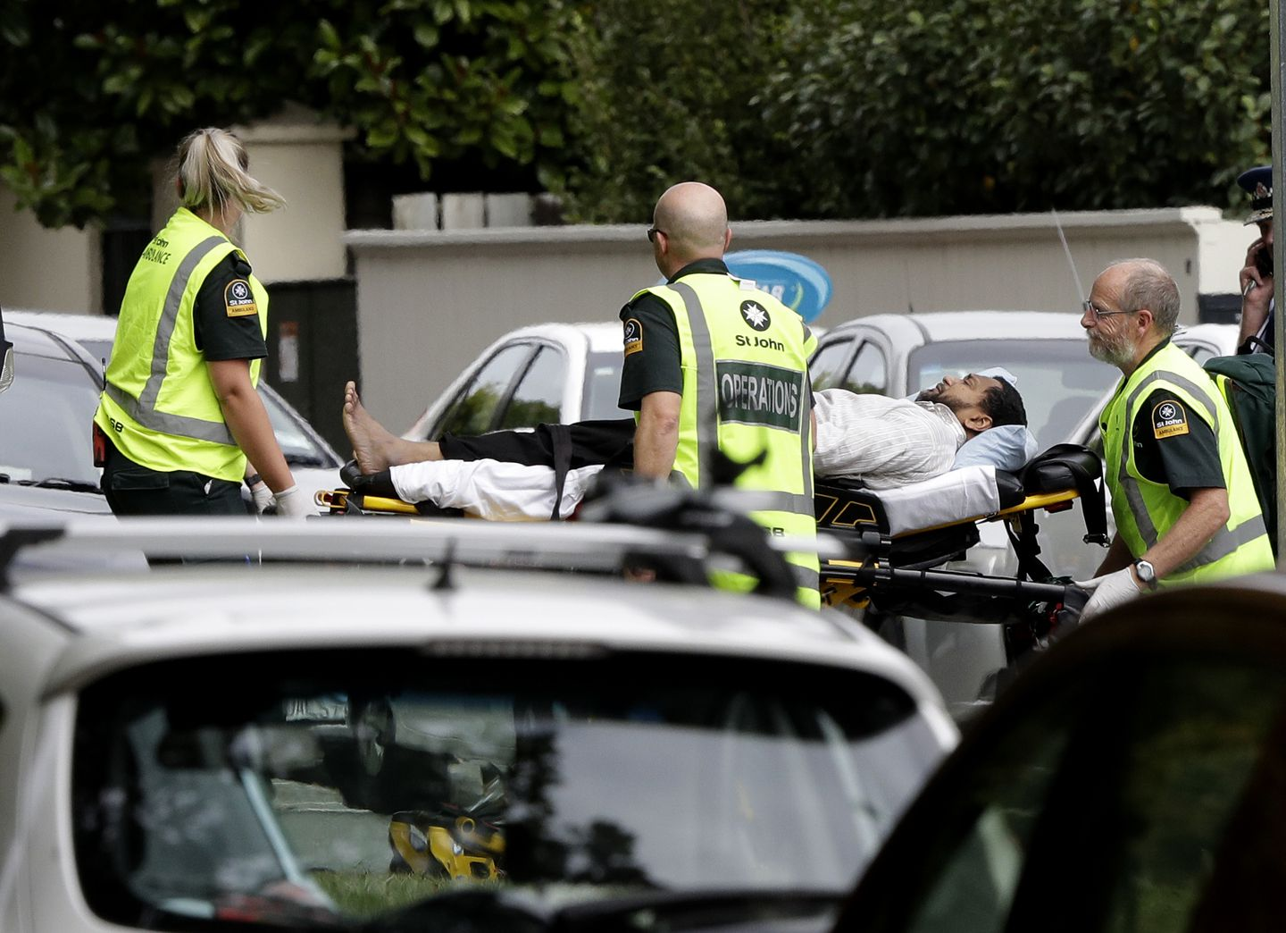 Ambulance staff took a man from outside a mosque in central Christchurch, New Zealand.