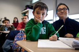 Max Lo, 5, and his father York Lo, listen as teacher Jennie Yue instructs children in the Chinese as a Second Language/Level One class at the Acton Chinese Language School.