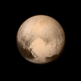 Scientists said they found vast frozen plains spanning a couple hundred miles in the heart-shaped area of Pluto, next door to its big, rugged mountains of water ice.
