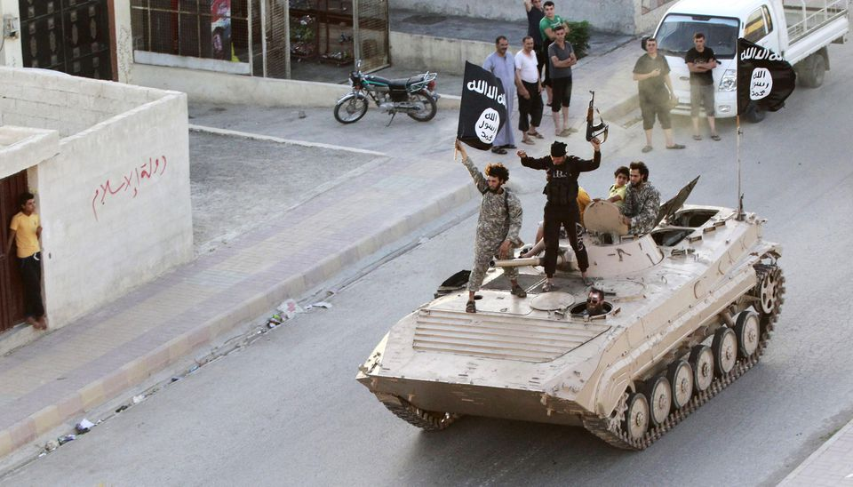 Islamist militants participated in a military parade in June in the streets of Syria's Raqqa province.
